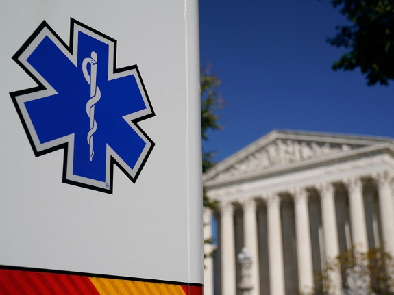 An ambulance parks outside the U.S. Supreme Court in Washington