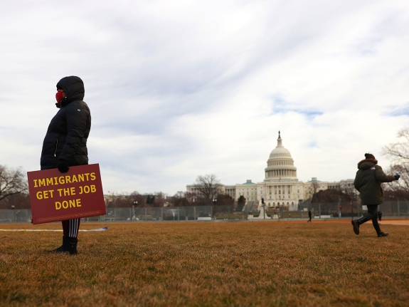 Immigrant essential workers rally near the U.S. Capitol in Washington