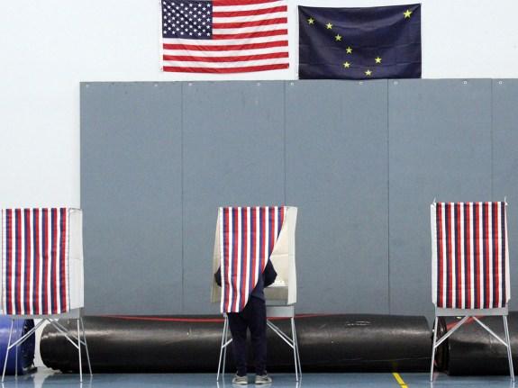 A voter fills out their ballot in Alaska.