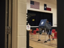 A voter casts their ballot at an early voting polling location in Texas