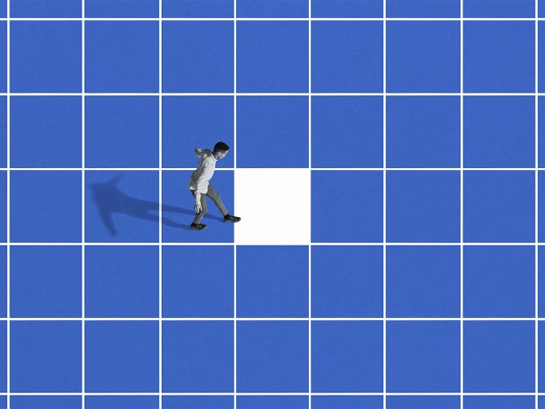 Side view of young man walking on blue grid