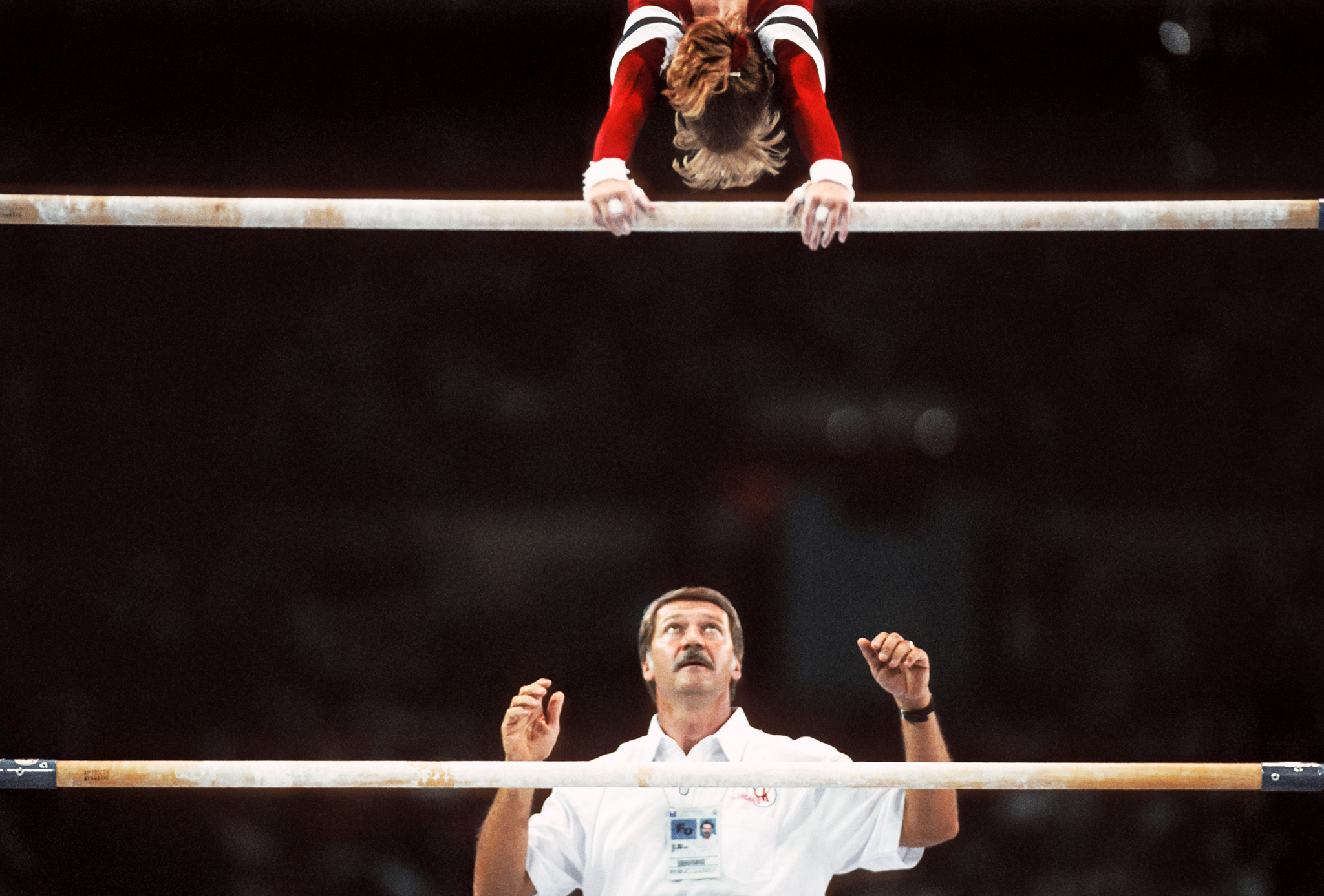 Coach Béla Károlyi spotting gymnast Kim Zmeskal