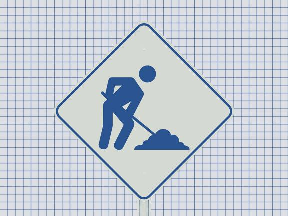 A photo illustration of a construction sign on a gridded background