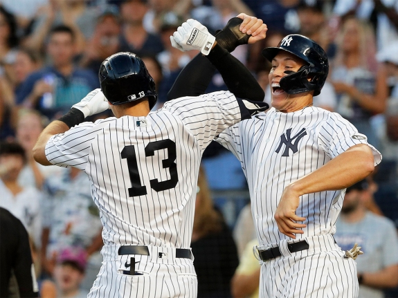 Joey Gallo #13 of the New York Yankees celebrates with teammate Aaron Judge