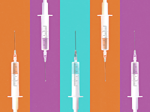 A photo illustration of five COVID-19 vaccine syringes