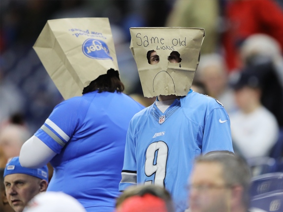 A Detroit Lions fan wears a paper bag while watching a game