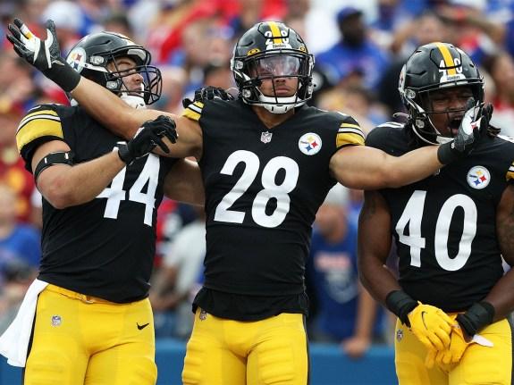 Derek Watt #44, Miles Killebrew #28, and Jamir Jones #40 of the Pittsburgh Steelers celebrate