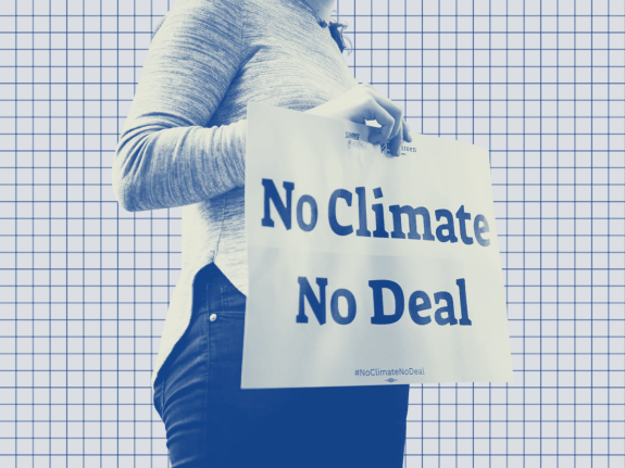 """A photo illustration of a demonstrator holding a """"No Climate No Deal"""" sign on a gridded background"""