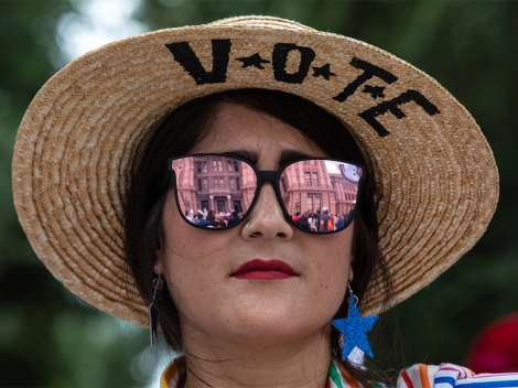 A woman attends a voting rights rally outside of the Texas State Capitol